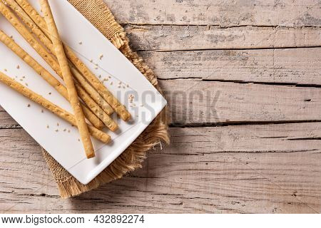 Breadstick Grissini Snack On Rustic Wooden Table. Top View. Copy Space