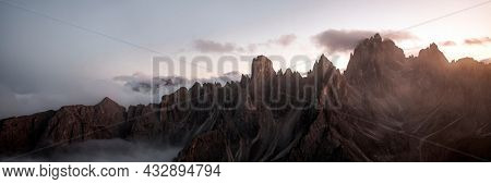 View of foggy Tre Cime di Lavaredo in Dolomites, Italy
