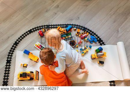 Preschool Boys Drawing On Floor On Paper, Playing With Educational Toys - Blocks, Train, Railroad, V