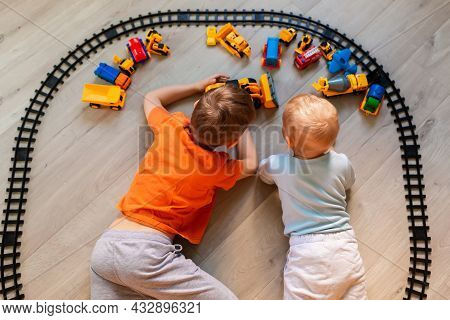 Preschool Boys Playing With Educational Toys - Blocks, Train, Railroad, Vehicles At Home Or Daycare.