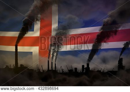 Dark Pollution, Fight Against Climate Change Concept - Factory Pipes Heavy Smoke On Iceland Flag Bac