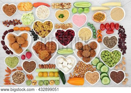Healthy vegan diet food for good health with meat substitute products. Natural organic sustainable ethical eating save the planet concept. Flat lay top view  on rustic wood.