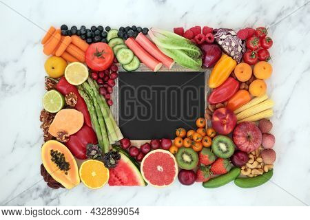 Antioxidant health food to reduce blood pressure and cholesterol levels high in anthocyanins, carotenoids, vitamins, protein, omega 3, fibre,  smart carbs. Blackboard with copy space on marble.