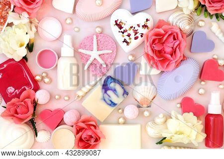 Skin care beauty treatment products for pamper session concept. Abstract background with rose and freesia flowers. Natural health care concept. On pink marble.