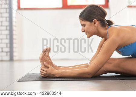 Yogi Woman Doing Stretching In Seated Forward Bend Position, Healthy Life
