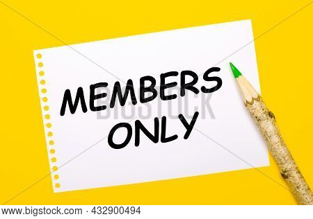 On A Bright Yellow Background, A Large Wooden Pencil And A White Sheet Of Paper With The Text Member