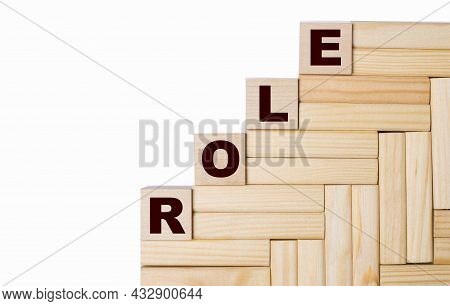 On A Light Background, Wooden Blocks And Cubes With The Text Role