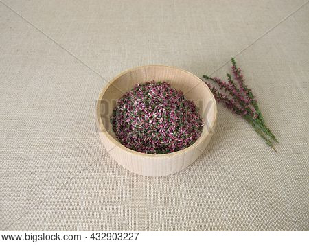 Dried Flowers From Heather Herb In A Wooden Bowl