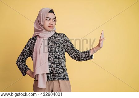 Muslim Woman Wearing Hijab With Hand Gesture Pose Rejecting Offer With Space