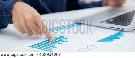 Hand Of Young Business Man Pointing Document Data Graph And Chart Paper, Marketing And Investment, R