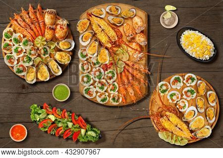 Lobster Thermidor, grilled lobster , scallops, grilled oysters and mussels with cheese, grill cuttlefish, scallops in wooden plate with lime. Isolated on wooden background. Menu baner