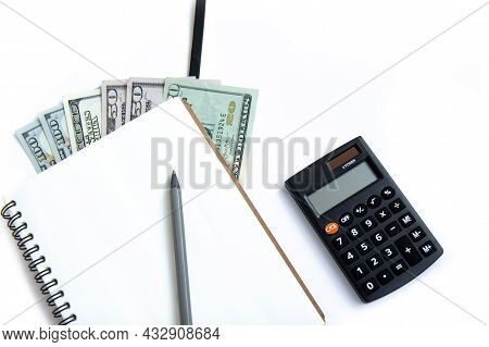 Calculator, Pen, Open Notepad And Paper Money Isolated On White Background