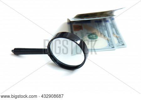 Magnifier And Paper Money Isolated On White Background