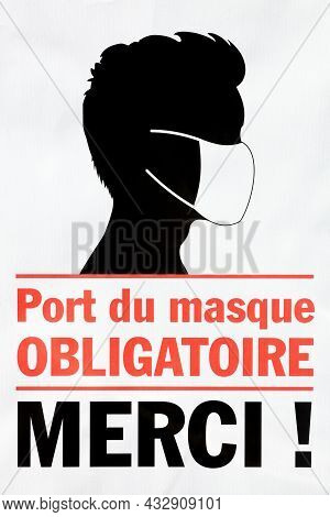 Wearing A Mask Is Compulsory, Thank You Symbol Called Port Du Masque Obligatoire Merci In French Lan