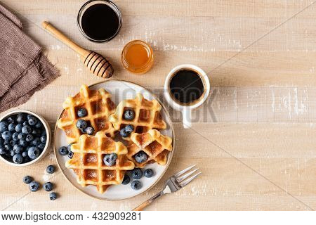 Sweet Belgian Waffles With Blueberries, Honey And Cup Of Coffee