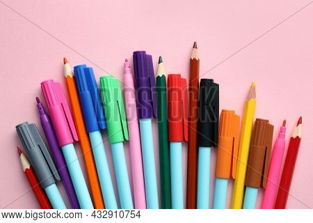 Different Colorful Pencils And Felt Tip Pens On Pink Background, Flat Lay. Diversity Concept