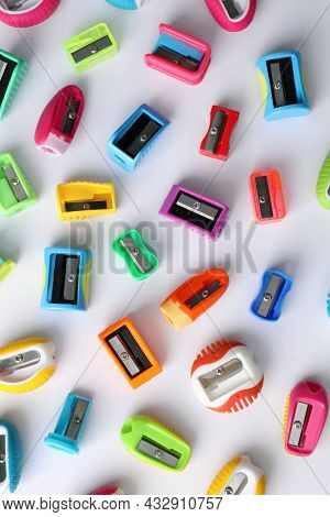 Many Different Colorful Sharpeners On White Background, Flat Lay. Diversity Concept