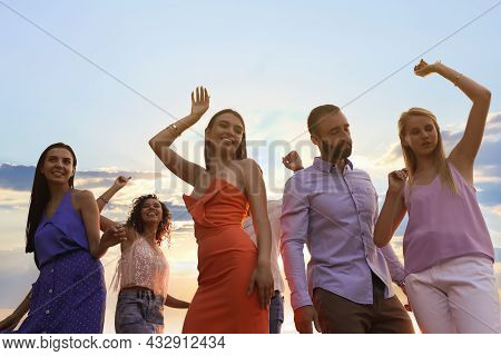 Group Of Friends Having Fun At Summer Party, Low Angle View