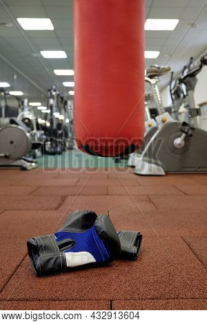 Boxing Gloves And Punching Bag In The Gym. Gloves For Mixed Martial Arts.