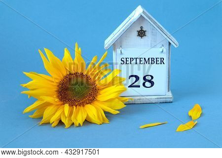Calendar For September 28 : Decorative House With The Name Of The Month In English, Number 28, Yello