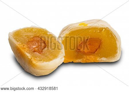 Two Halves Of Chinese Patry Or Moon Cake Filled With Mashed Mung Bean And Salted Egg Yolk On White B