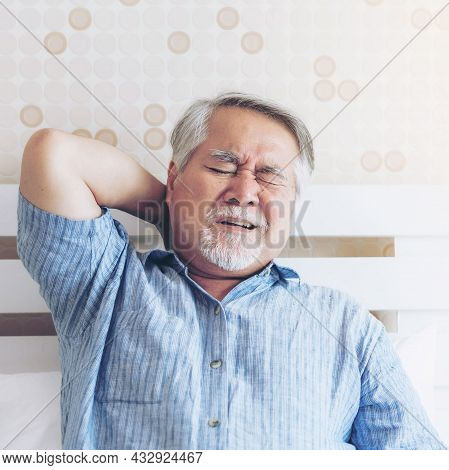 Senior Asian Man , Old Man He Wake Up And Sat On The Bed , He Had Pain In The Nape Of His Neck Cause