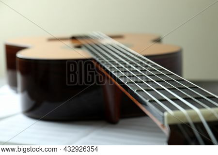 Classical Guitar And Music Sheet, Close Up And Selective Focus