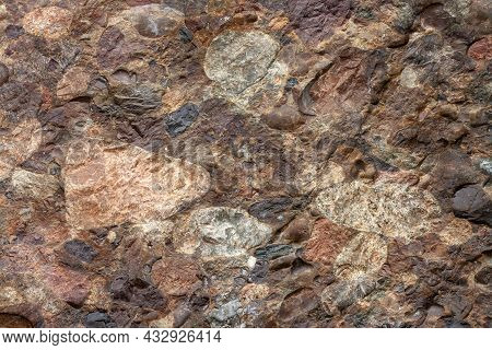 Geological Section Of Rocky Slab Consisting Of Different Stones. Horizontal Image.