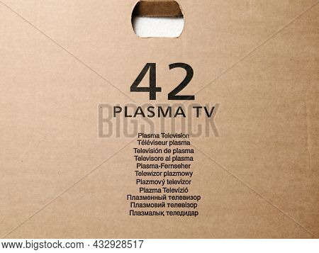 Signage On Large Cardboard Plasma 42 Inch Display With Plasma Television Text Written In All Interna