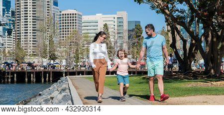 Friendship. Father Mother And Child Walk In Park. Friendly Family Having Fun In Summer.