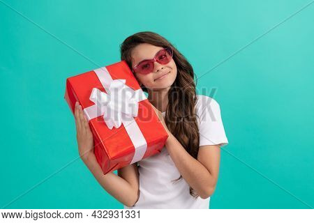 Fashionable Happy Teen Girl In Sunglasses Hold Gift Box, Occasion Greeting