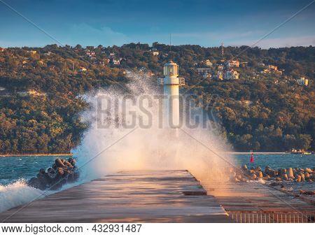 Lighthouse And Splashing Wave In Varna, Bulgaria