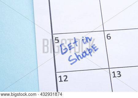 Get In Shape Reminder Writted By Blue Marker In A Calendar.