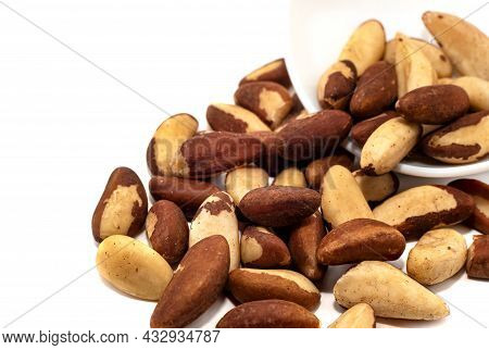 Brazil Nut On A White Background Close-up. Nuts In A Bowl Isolate. Energy Valuable Products