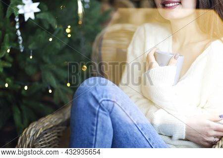 Crop Stylish Lady Sniffing Aromatic Hot Drink While Resting On Brightly Illuminated Background Of Ch