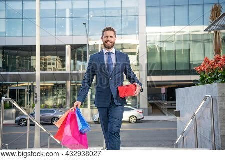 Successful Ceo Holding Gift Packs Outdoor. Handsome Man Prepare For Romance Date.