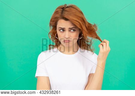 Unhappy Redhead Woman With Curly Hair On Blue Background, Disappointment