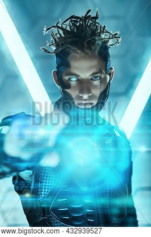 Warrior of the future. A brave cyberpunk warrior in protective uniform reaches out to the camera standing in neon light. Game, virtual reality.
