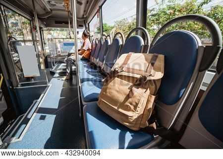 One Lost Bag Or Backpack Lie On Bus Seat
