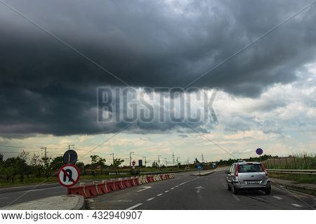 Dramatic Cloudy Sky Over The Road, Traffic In The City. Bucharest, Romania, 2020