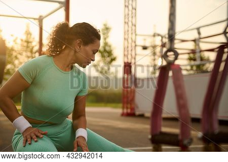 Close-up Of Attractive Athlete Woman Doing Warm-up, Warming Up Before Training Outdoors In Summer Sp