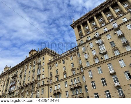 Facade Of A Multi-storey Panel Building. Residential Building With Many Apartments. Apartment House,