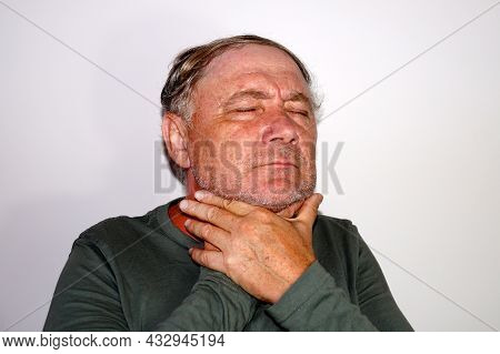 Middle-aged Man Holds His Sore Throat With His Hands, Portrait Of A Sick Man