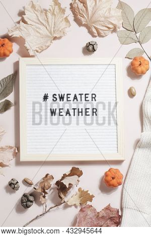 Felt Letter Board And Text Sweater Weather With Leaves, Pumpkins And Sweater On Beige Background. Au