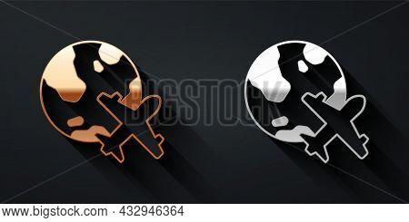 Gold And Silver Globe With Flying Plane Icon Isolated On Black Background. Airplane Fly Around The P