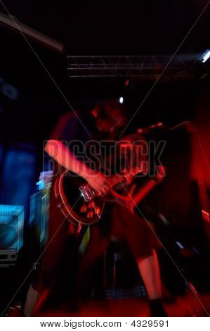 Rock-guitarist On Live Concert With Motion Effect