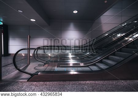 A Side View Of A Modern Doubled Escalator Made Of Metal And Glass Indoors Of A Contemporary Airport