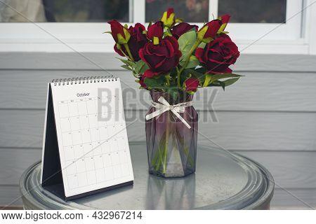 Calendar Desk And Rose Flower On Table. Desktop Calender For Planner To Plan Wedding Agenda, Timetab
