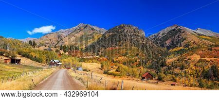 Panoramic view of Colorful fall foliage on slopes of San Juan mountains along Last Dollar Road in rural Colorado