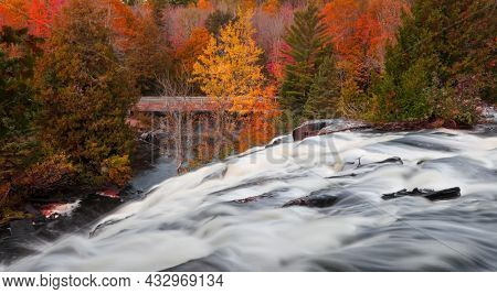 Scenic Bond falls during autumn time in Michigan upper peninsula